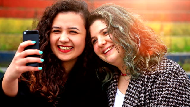 hd: two young girls taking a selfie - turkish ethnicity stock videos & royalty-free footage