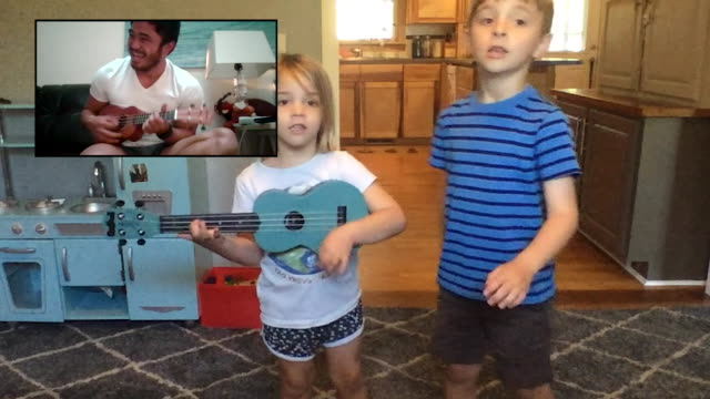 two young kids dance along with their adult friend playing the ukulele via video call. - learning stock videos & royalty-free footage