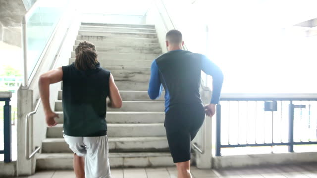 two young men exercising, running up stairs - steps and staircases stock videos & royalty-free footage