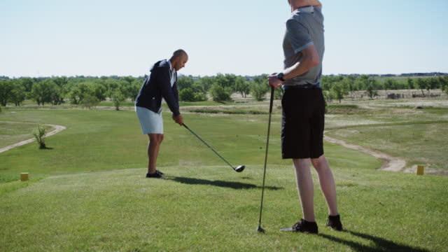 two young men golf together - green golf course stock videos and b-roll footage