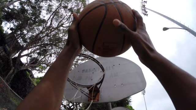 pov of two young men playing basketball together. - slow motion - basketball stock-videos und b-roll-filmmaterial