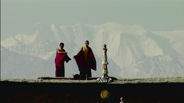 ws two young monks playing horns, mountains in background / tsarang, mustang, nepal - tibet stock videos & royalty-free footage