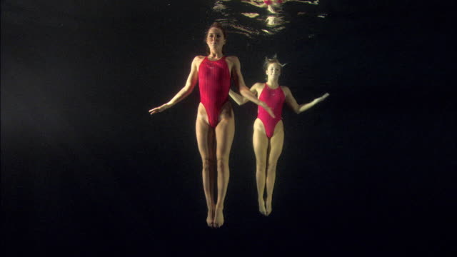 WS, Two young synchronized swimmers underwater, Basildon, Essex, United Kingdom