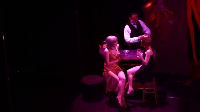 Two young Tango dancers sitting at a bar during the show 'Tango Porteno' in Buenos Aires Argentina dancing in a spot light