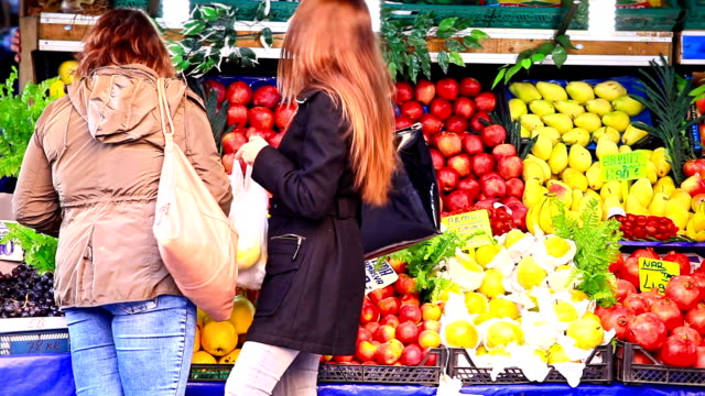 HD: Two Young Woman at the Market