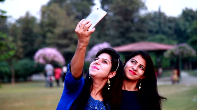 two young woman talking a selfie - teenage girls stock videos & royalty-free footage