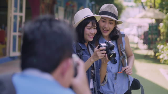 Two young woman traveler with photo camera and backpack on the city Travel Lifestyle.Teenage Viewpoint on the World concept.