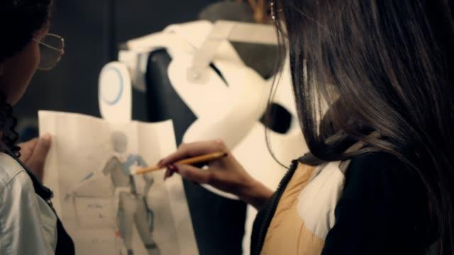 två unga kvinna som arbetar i trä workshop - middle eastern ethnicity bildbanksvideor och videomaterial från bakom kulisserna