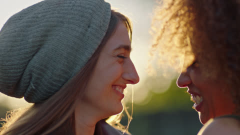 cu slo mo. two young women gaze at each other and laugh. - falling in love stock videos & royalty-free footage