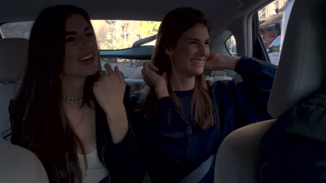 two young women in back seat of car, daytime - passenger seat stock videos & royalty-free footage