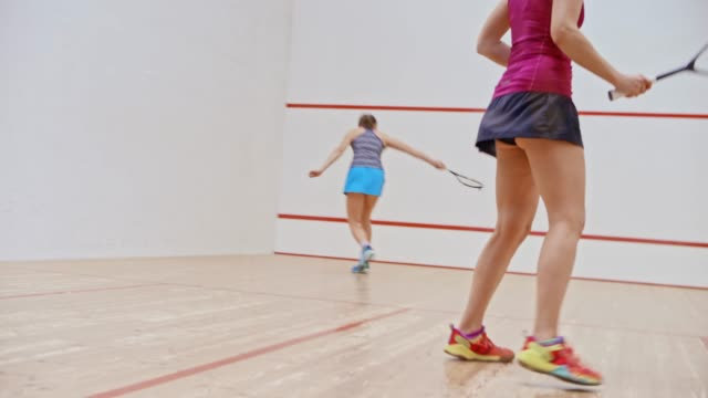 two young women playing a game of squash - squash sport stock videos & royalty-free footage