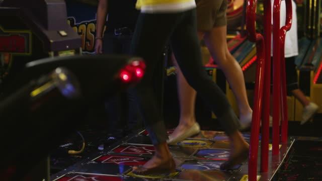 vídeos y material grabado en eventos de stock de ms td tu two young women playing on dance game, orem, utah, usa - orem