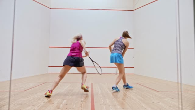ld two young women playing squash - squash sport stock videos & royalty-free footage