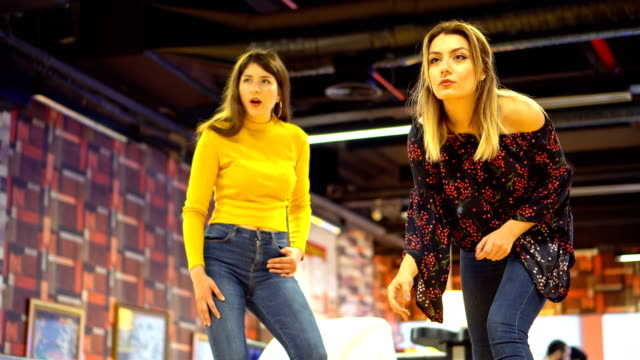 two young women plays bowling - bowl stock videos & royalty-free footage