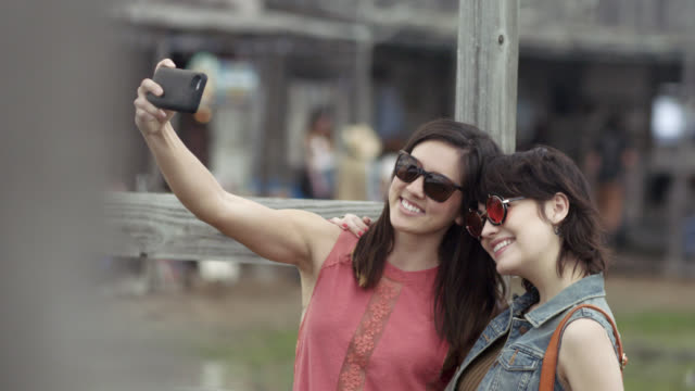 Two young women pose for a smartphone selfie in Texas ghost town
