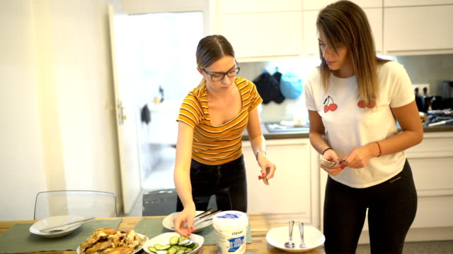 two young women setting the table - setting the table stock videos & royalty-free footage