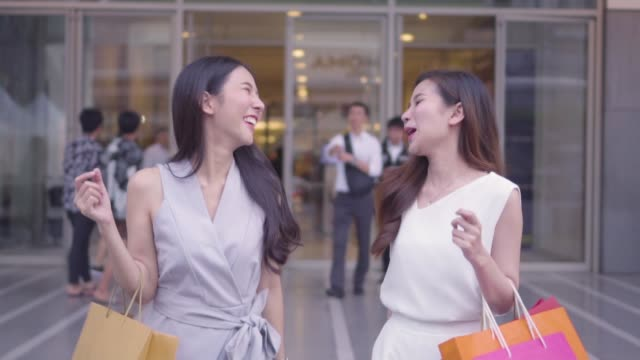 two young women shopping in a department store,slow motion - 25 29 years stock videos and b-roll footage