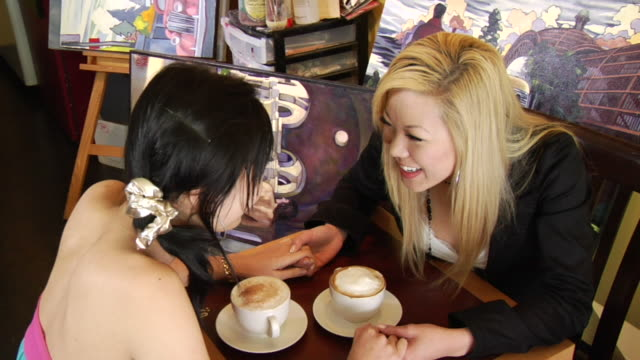 ha ms portrait two young women sitting at table in coffee shop, holding hands and talking/ women looking up at camera/ vancouver, bc - 2007 stock videos & royalty-free footage