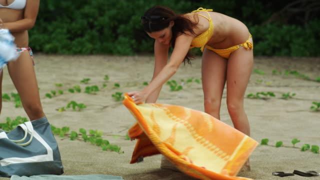 two young women sunbathing - ビキニ点の映像素材/bロール