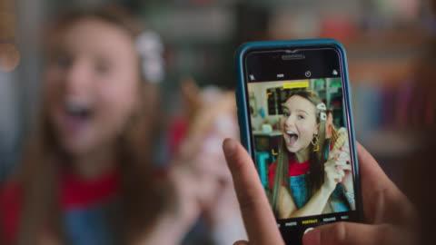 two young women take selfies together while holding ice cream at an ice cream shop - fotografi konst och konsthantverksföremål bildbanksvideor och videomaterial från bakom kulisserna