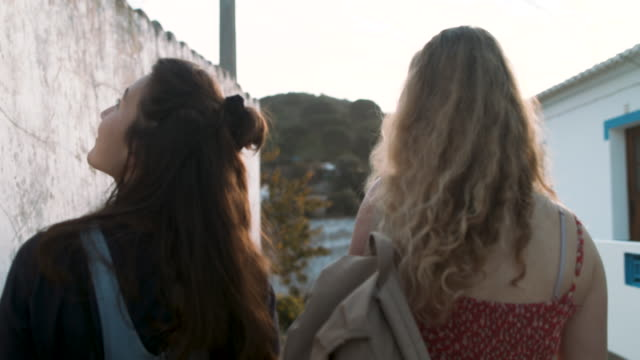 two young women walking in town - carefree stock videos & royalty-free footage