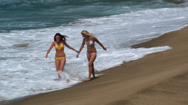 two young women walking on the beach - 14 15 years stock videos and b-roll footage