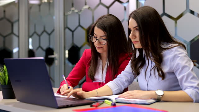 two young women working in the office - employee engagement stock videos & royalty-free footage