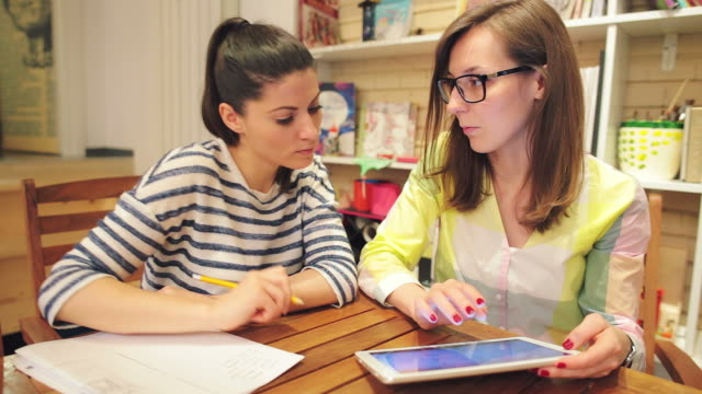Two young women working together in a bookstore.
