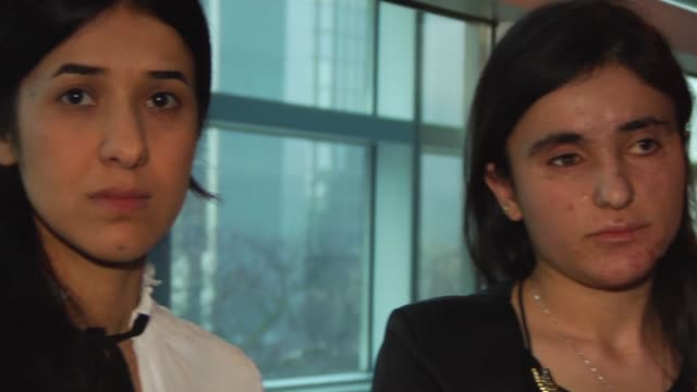 two young yazidi women, nadia murad and lamia haji bashar who survived sexual enslavement by the islamic state group were awarded the 2016 sakharov... - award stock videos & royalty-free footage
