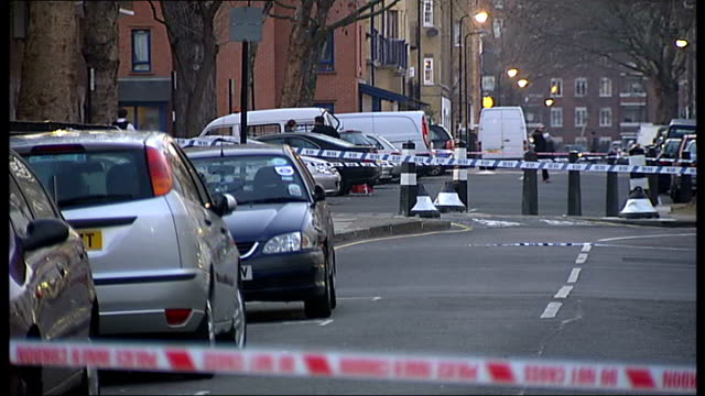 Two youths stabbed in Euston area ENGLAND London Euston Police cordon tape in road and police officers outide Cock Tavern pub