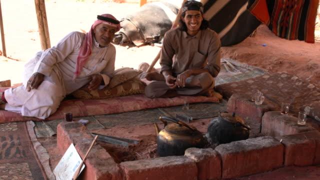 Two Zalabia Bedouins drinking tea in a camp in Wadi Rum Desert, Jordan