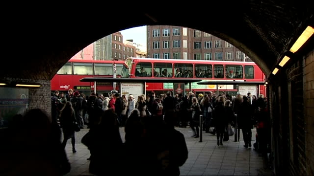 twoday tube strike begins in london london ext person in crowd being directed by police officer london underground worker giving directions to woman... - taxi rank stock videos & royalty-free footage