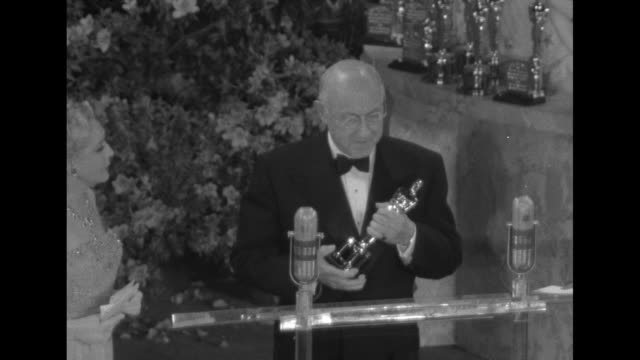 twoshot director cecil b demille and actress/presenter mary pickford banter about being oldtimers as demille holds his oscar for best picture which... - cecil b. demille stock videos & royalty-free footage