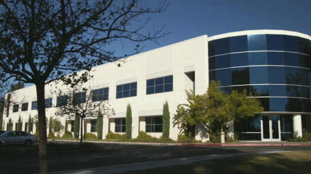 ms pan two-story office building, hollywood, california, usa - office block exterior stock videos & royalty-free footage