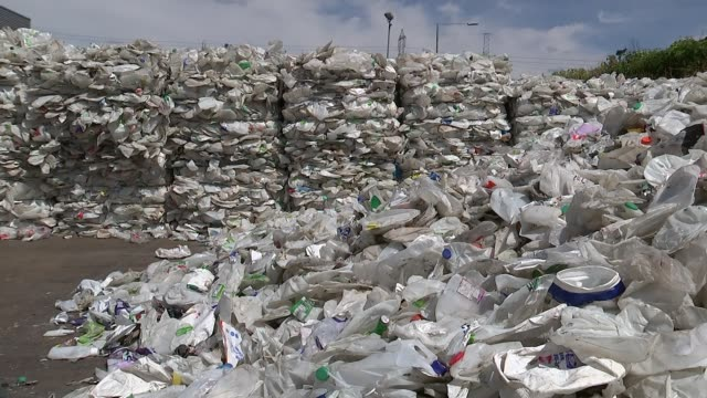 two-thirds of plastic used in food packaging cannot be recycled; england: various of piles of discarded plastic at recycling plant - raw footage stock videos & royalty-free footage