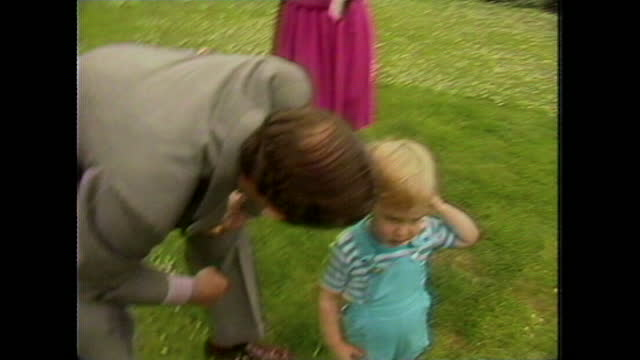"""two-year-old prince william points and asks """"dat"""" and prince charles responds saying it is a microphone, during a photocall at kensington palace... - toddler stock videos & royalty-free footage"""