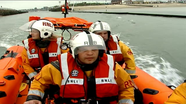 twoyearold toddler dies in english channel england sussex littlehampton ext general views of members of royal national lifeboat team along sea in... - sea channel stock videos and b-roll footage