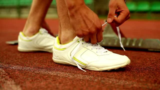Tying a shoe before running