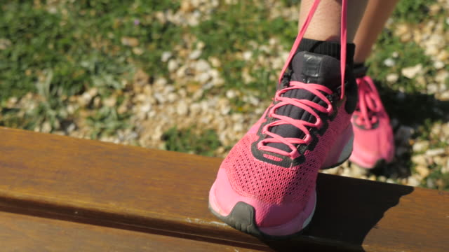 tying her sports shoes - shoe stock videos & royalty-free footage