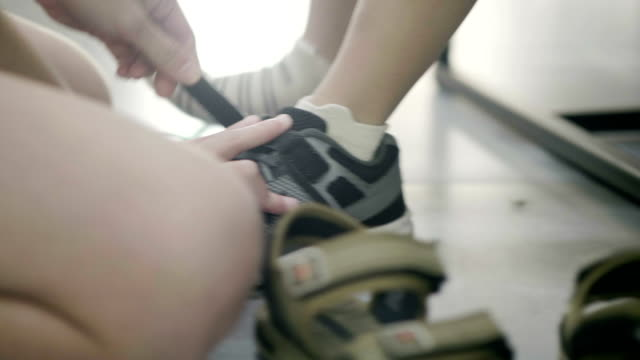 tying his son's shoelace - footwear stock videos & royalty-free footage