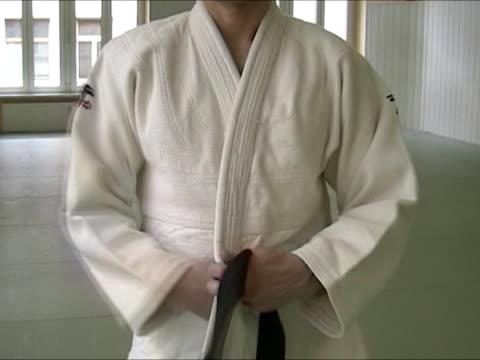 tying judogi - belt stock videos & royalty-free footage