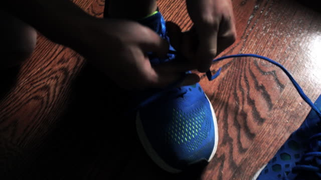 tying sneakers - tied up stock videos & royalty-free footage