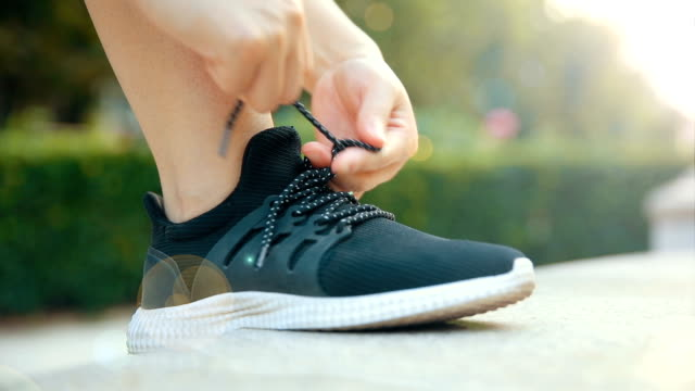 tying sports shoes for running - shoelace stock videos and b-roll footage