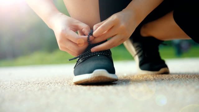 Tying sports shoes for running