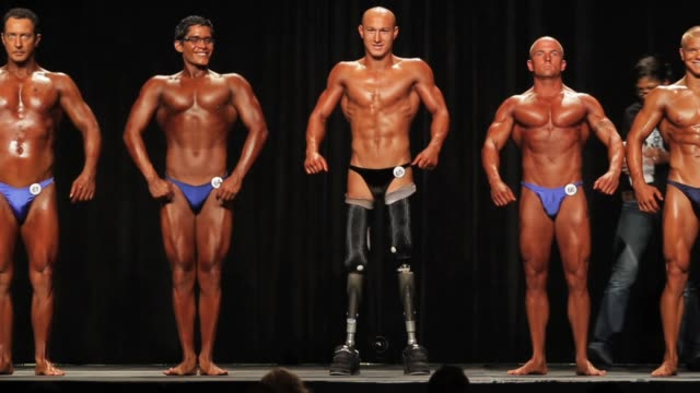 tyler carron a former berthoud high school wrestler who lost his legs in a car accident bulks up while securing a spot on the us national sled hockey... - body building stock videos & royalty-free footage