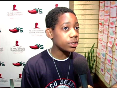 tyler williams on loving st jude's on supporting kids who are less fortunate at the chili's create a pepper to benefit st jude children's research... - chili's grill & bar stock videos and b-roll footage