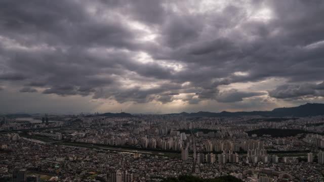tyndall phenomenon over jungnang-gu district and yongmasan mountain in seoul - light natural phenomenon stock videos & royalty-free footage