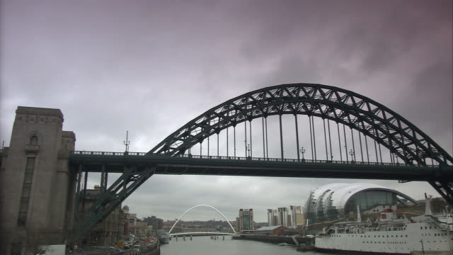 tyne bridge and gateshead millennium bridge in newcastle, pan, uk - newcastle upon tyne stock videos & royalty-free footage