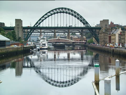 tyne bridge and reflection in river tyne newcastle - tyne bridge stock videos & royalty-free footage