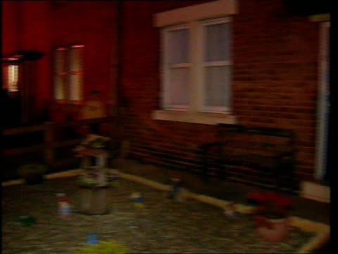 stockvideo's en b-roll-footage met tyneside ext at night police officer at door of house pan bv police officer along street track police officers away from house - middelenmisbruik